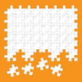 Jigsaw puzzle pieces white on orange background Royalty Free Stock Photo