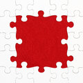 Jigsaw puzzle on red background Royalty Free Stock Photo