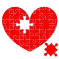 Jigsaw puzzle in the  red heart Royalty Free Stock Photo