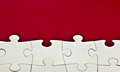 Jigsaw on red background Royalty Free Stock Photo