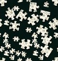 Jigsaw wallpaper seamless pattern of puzzle pieces for conceptual backgrounds Royalty Free Stock Photo