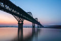 The jiujiang bridge in nightfall yangtze river for double railway highway Stock Photography
