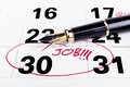 Job deadline calendar with marked with red founain pen on the th for fining Stock Photos