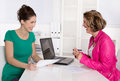 Job interview or business meeting under two woman. Royalty Free Stock Photo