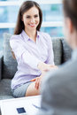 Job interview business women shaking hands and smiling Royalty Free Stock Photo