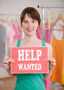 Job offer woman with help wanted sign store owner holding Stock Image