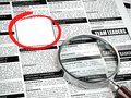 Job search concept. Loupe, newspaper with employment advertiseme
