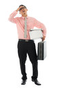 Jobless fired asian corporate employee holding his suitcase and belongings in a cardboard box isolated on white background Stock Image