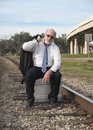 Jobless senior businessman on railroad track Royalty Free Stock Images