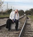 Jobless senior businessman on railroad track Royalty Free Stock Photo