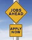 Jobs ahead conceptual road sign on or employment Royalty Free Stock Image
