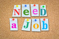 Jobs and career concept with colorful paper pins on cork board