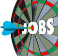 Jobs career dartboard dart successful employment a with word and a in the bullseye to illustrate succeeding in a job search and Royalty Free Stock Images