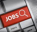 Jobs finding button on red keyboard Stock Photography
