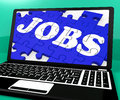 Jobs Puzzle On Notebook Shows Online Applications Royalty Free Stock Photo
