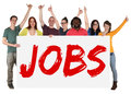 Jobs sign group of young multi ethnic people holding banner Royalty Free Stock Photo