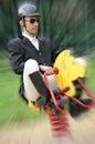 Jockey funny with wooden horse Royalty Free Stock Photos
