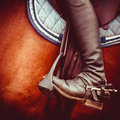 Jockey riding boot horses saddle and stirrup vintage stylized photo of Stock Photo
