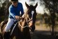 Jockey riding horse at barn Royalty Free Stock Photo