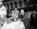 Joe dimaggio and casey stengel former new york yankee great of his manager shake hands at a parade honoring image taken from a Royalty Free Stock Image