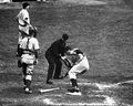 Joe dimaggio steps on homeplate former new york yankees great home plate during a game image taken from a black and white negative Royalty Free Stock Photos