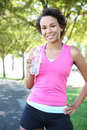 Jogger Drinking Water in Park Stock Images