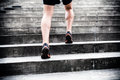 Jogger running on stairs sports training man runner in city sport young male athlete and doing workout outdoors in city fitness Stock Photo