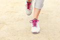 Jogger s legs on sand a picture of Stock Photography
