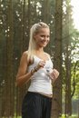 Jogging blonde woman with water Royalty Free Stock Photos