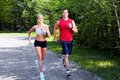 Jogging couple young in park health and fitness Royalty Free Stock Image
