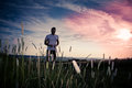 Jogging through the fields Royalty Free Stock Photo