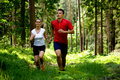 Jogging in forest Stock Photography