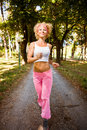 Jogging in the park woman shape running Stock Photo