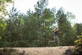Jogging on sandy scarp woman in the forest Stock Photo