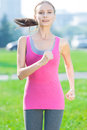 Jogging woman running in city park sunshine on beautiful summer day sport fitness model caucasian ethnicity training outdoor Stock Photo