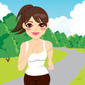 Jogging woman running in park beautiful happy young outdoors Stock Photos
