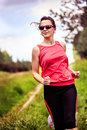 Jogging woman young in front of rural landscape Stock Photos