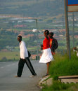 Johannesburg south africa december strangers two me men and a woman crossing the road in road city in the Stock Photo