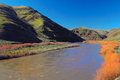 John day river the banks of the at the bottom of steep canyon hills in eastern oregon Stock Image