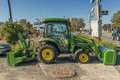 John deere tractor engineers designed the cx front end loader to fit a wide range of its compact models Stock Photos