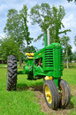 John deere tractor portrait old antique sitting in a grassy field for display Royalty Free Stock Images