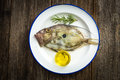 John dory fish on a wooden board Royalty Free Stock Photography