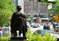 John harvard statue on harvard square overlooking in cambridge massachusetts Stock Image