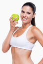 Join healthy lifestyle attractive young woman in white bra and panties holding green apple and smiling while standing isolated on Stock Image