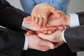 Joined hands of business people closeup shot Stock Image