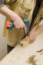 Joiner making furniture in his manufactory Royalty Free Stock Photo