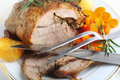 Joint of lamb with carving implements Stock Photos