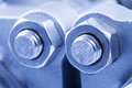 Joint of two flanges by bolts and nuts close up Stock Image