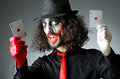 Joker with cards in studio Royalty Free Stock Image