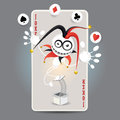 Joker harlequin make juggling performance with spade club diamond heart balls in front of big card Royalty Free Stock Image